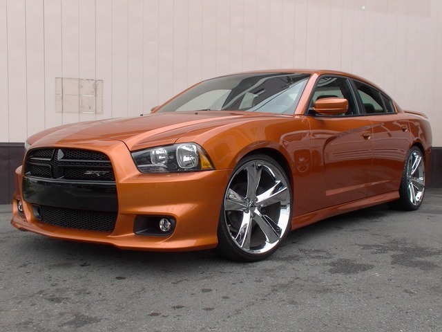 2011年モデル ダッジ チャージャー SE が入庫しました!自社輸入車輌!! ボディカラーは国内では大変希少なオレンジパール!! 派手過ぎず、しっかりと個性を主張してくれます! ノーマルの状態で入庫後に22inchアルミホイール&ローダウンを施しました! アルミ&タイヤ共に新品です! そして、純正SRT8ボディキットを装着することにより さらにスポーティーで迫力あるスタイルの完成です!! 是非、実車をご確認下さいませ!  【主装備】 ★純正SRT8ボディキット (フロントバンパー/サイドスポイラー/リアバンパー/トランクスポイラー) ・カスタムレザーインテリア(ブラック&オレンジ) ・SRT8スタイル 22inchアルミホイール ・ローダウンサス ・デュアルオートエアコン ・運転席パワーシート ・4.3inchタッチスクリーンモニター ・プッシュエンジンスタート など  国内ナビゲーション、ETC、バックカメラなどの装着も お気軽にお問合せ下さいませ!  ★この車への「お問…